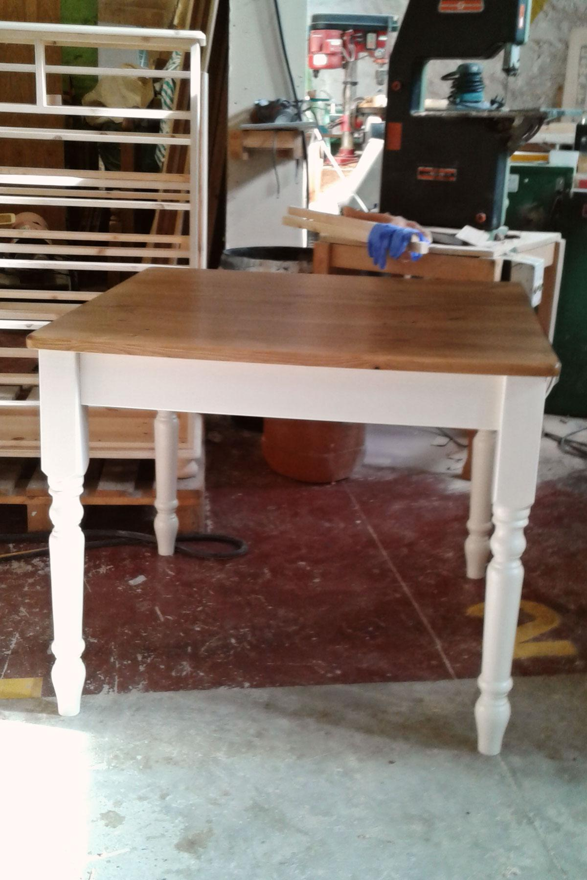 Custom made pine table with painted legs.